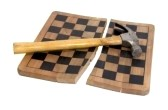 5911380-game-over-shown-by-hammer-with-a-wooden-handle-on-a-broken-wooden-chess-board